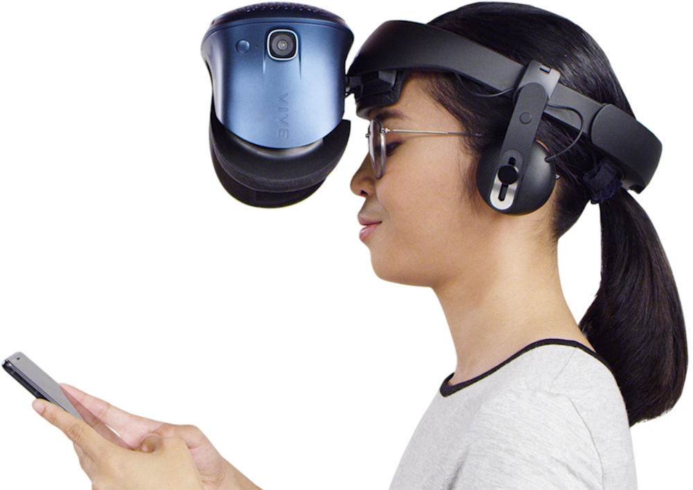 A woman wearing the Cosmos headset flipped up to allow her to view her phone